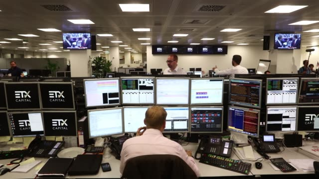 trader monitors financial data on computers screens at etx capital, a broker of contracts-for-difference, in london, u.k. on thursday, june 23 a... - city of london stock videos & royalty-free footage