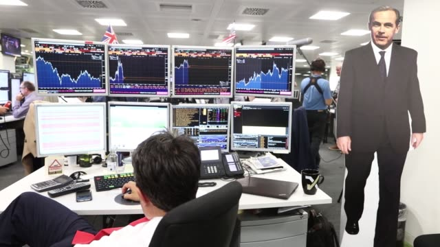 trader monitors financial data on computers screens at etx capital, a broker of contracts-for-difference, in london, u.k. on thursday, june 23... - 2016 video stock e b–roll