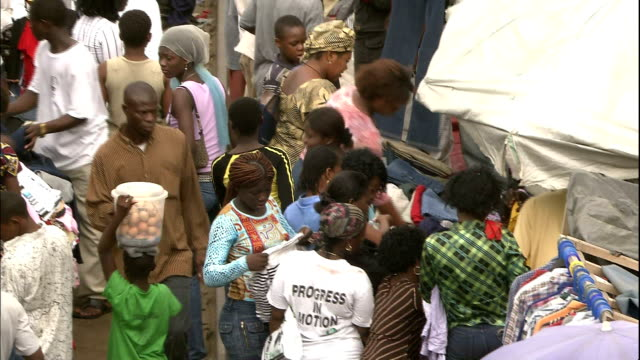 Traders and customers in crowded market, Nigera