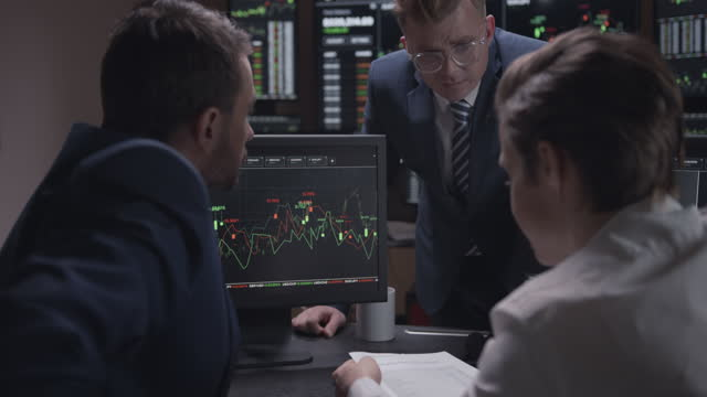 traders at the investment firm - cryptocurrency stock videos & royalty-free footage