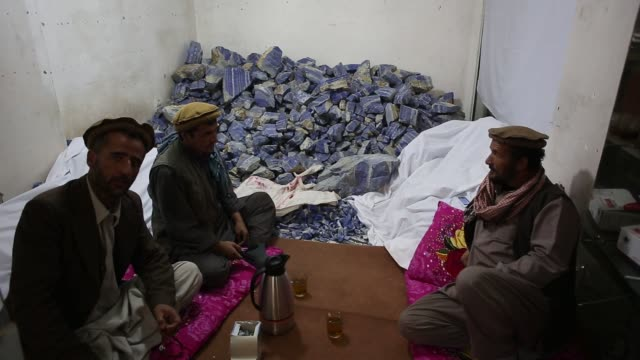 traders drink tea next to their store of raw lapis lazuli stones in a shop in kabul, afghanistan, wednesday, november 2015 afghanistan has for... - semi precious gemstone stock videos & royalty-free footage