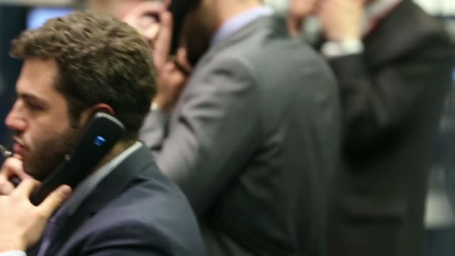 traders gesture as they work from the trading floor of the open outcry pit at the london metal exchange in london uk on tuesday april 8 a trader... - market trader stock videos & royalty-free footage