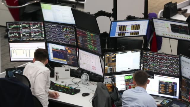 traders monitor data during the official opening of the stock trading floor at the headquarters of pjsc sberbank in moscow russia on tuesday jan 30... - handel treiben stock-videos und b-roll-filmmaterial