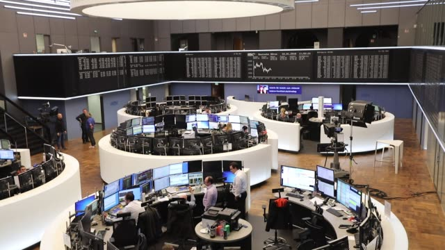 traders monitor financial data as the second iteration of the markets in financial instruments directive comes into force at the frankfurt stock... - frankfurt stock exchange stock videos and b-roll footage
