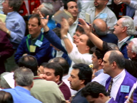 traders shouting + making hand signals on exchange floor / coffee, sugar + cocoa exchange, nyc - bull market stock videos & royalty-free footage