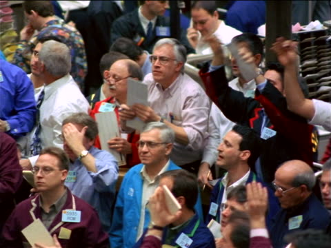 traders shouting + making hand signals on exchange floor / coffee, sugar + cocoa exchange, nyc - stock market stock videos & royalty-free footage