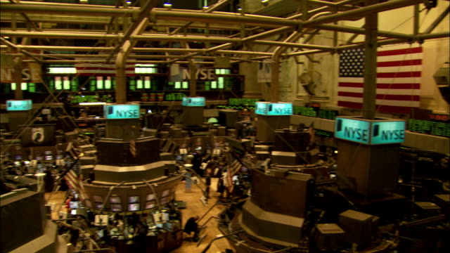 traders walk the floor of the new york stock exchange. available in hd. - wall street video stock e b–roll