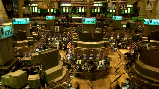 Traders work on the floor of the New York Stock Exchange. Available in HD.