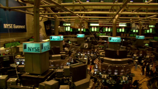 traders work on the floor of the new york stock exchange. available in hd. - new york stock exchange stock videos and b-roll footage