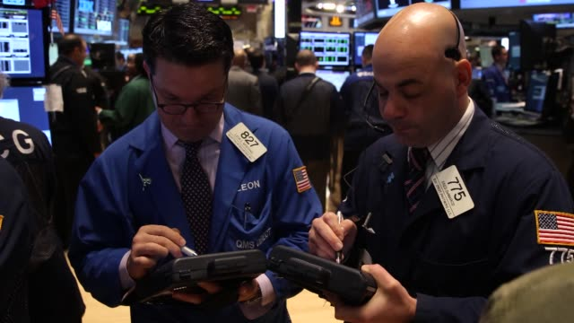 traders work on the floor of the new york stock exchange in new york u s on tuesday march 11 close up of three traders working as opening bell rings... - market trader stock videos & royalty-free footage