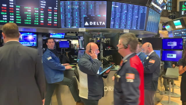 traders work on the floor of the new york stock exchange on march 02, 2020 in new york city. stocks were up slightly in morning trading following a... - market trader stock videos & royalty-free footage