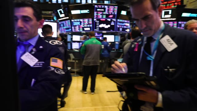 Traders work on the floor of the New York Stock Exchange on October 10 2018 in New York City Stocks fell sharply on Wednesday following a decline in...