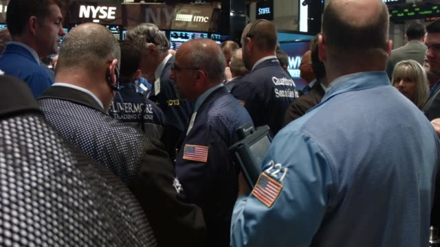 traders work on the floor of the new york stock exchange on october 15 2014 in new york city as fears from ebola and a global slowdown spread stocks... - stock trader stock videos and b-roll footage