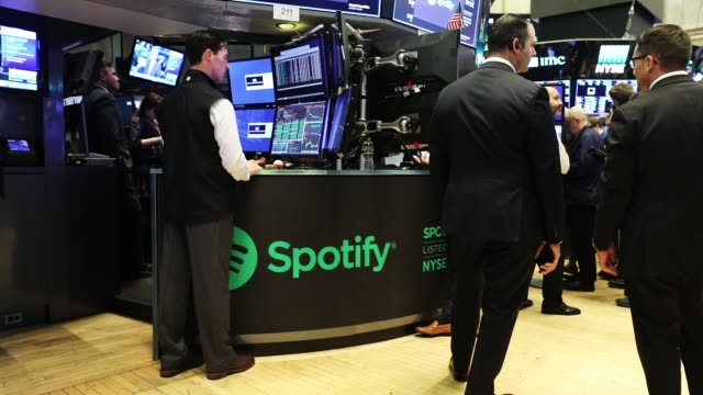 traders work on the floor of the new york stock exchange on the morning that the music streaming service spotify begins trading shares at the nyse on... - spotify stock videos & royalty-free footage