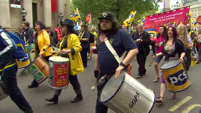 trades union congress members marching through london in a protest against low wages - marching stock videos & royalty-free footage