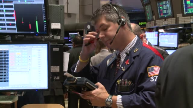 trading was volatile on friday on the new york stock exchange, as a better-than-expected us jobs report and hints of progress in europe's debt crisis... - crisi video stock e b–roll