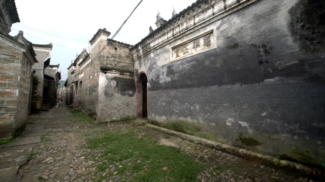 fuzhou, china - may 29, 2017: traditional alley with buildings in liukeng village - stationary process plate stock videos & royalty-free footage