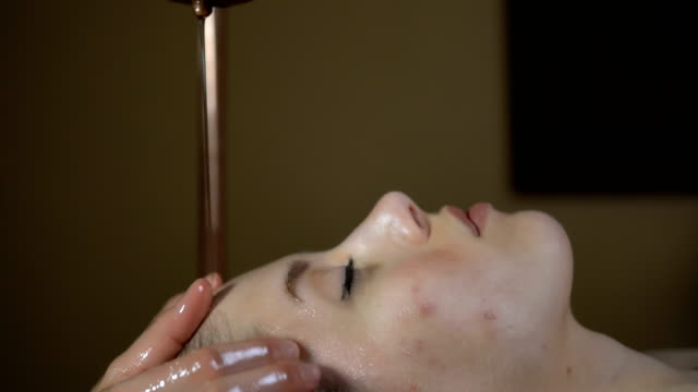 traditional ayurvedic treatment - massage table stock videos & royalty-free footage