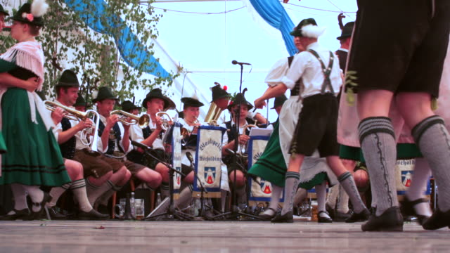 SLO MO Traditional Bavarian dance performed in a beer tent