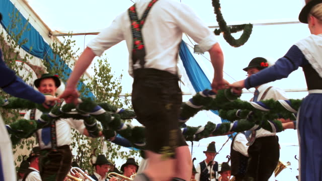 slo mo traditional bavarian dance performed in a beer tent - zelt stock-videos und b-roll-filmmaterial