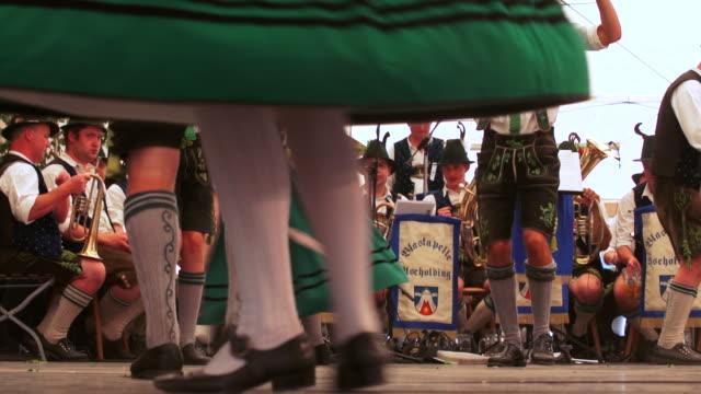 slo mo traditional bavarian schuhplattler dance performed in a beer tent - zelt stock-videos und b-roll-filmmaterial