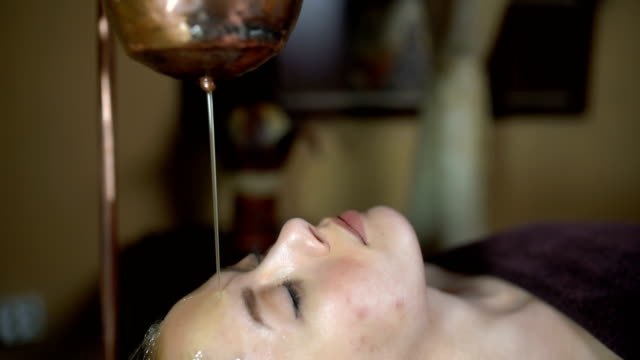 traditional beautification treatment - shirodhara stock videos & royalty-free footage