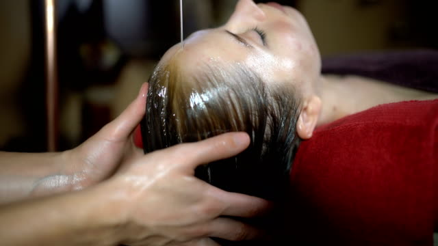 traditional beautification treatment - massage table stock videos & royalty-free footage