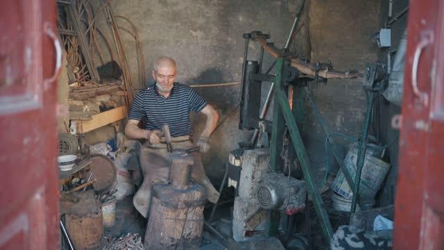 traditional blacksmith shop in the old city of kashgar,kashgar, xinjiang, china - produced segment stock videos & royalty-free footage