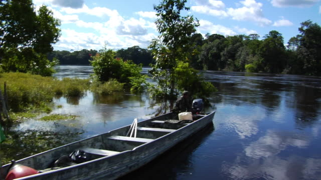 slo mo ws pan traditional boat on aupes riverbank, border with colombia / sao gabriel da cachoeira, amazonas, brazil - riverbank stock videos & royalty-free footage