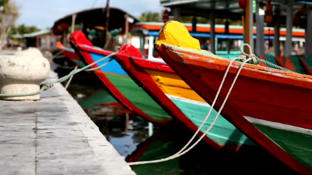 traditional boats in hoi an old town harbour in vietnam - traditionally vietnamese stock videos & royalty-free footage