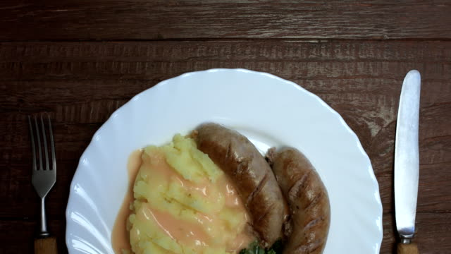 traditional british dishes. bangers and mash - mashed potatoes stock videos & royalty-free footage