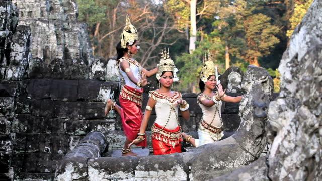 Traditional Cambodian apsara dancers perform at  Angkor Wat.