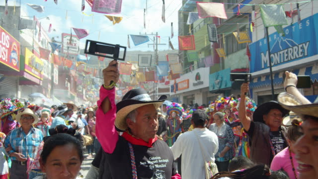 traditional carnival at a mexico ocozocoautla de espinosa village. people using carrack noisemakers during the parade - cowboy hat stock videos & royalty-free footage