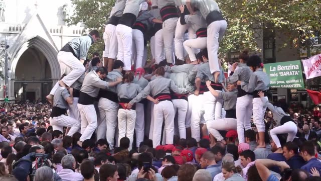 A traditional Catalan human tower is built by members climbing out of the crowd in the Terrassa province of Barcelona Spain on Sunday Nov 16...