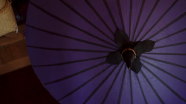 a traditional chiang mai purple umbrella. - effigy stock videos & royalty-free footage