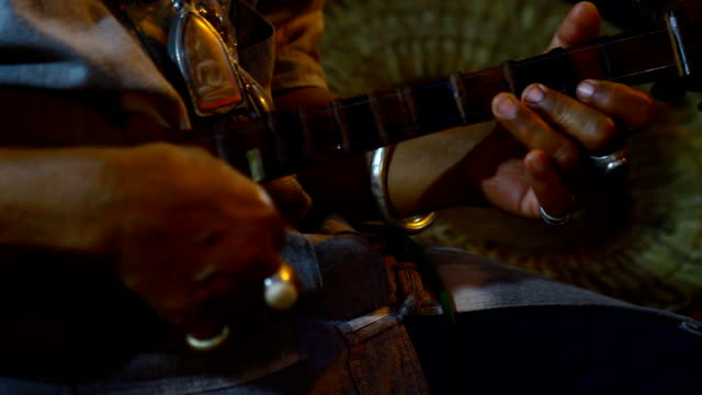 traditional chiang mai wood guitar ,thailand - folk music stock videos and b-roll footage