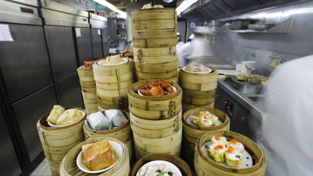 traditional chinese rice and dim sum steamers being prepared in a busy restaurant kitchen, central, hong kong, china - model and property released -time-lapse - covering stock videos and b-roll footage