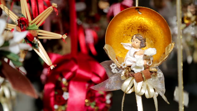 traditional christmas ornaments on a street in an european city. outdoors - palla dell'albero di natale video stock e b–roll