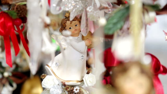 traditional christmas ornaments on a street in an european city. outdoors - negozio di giocattoli video stock e b–roll