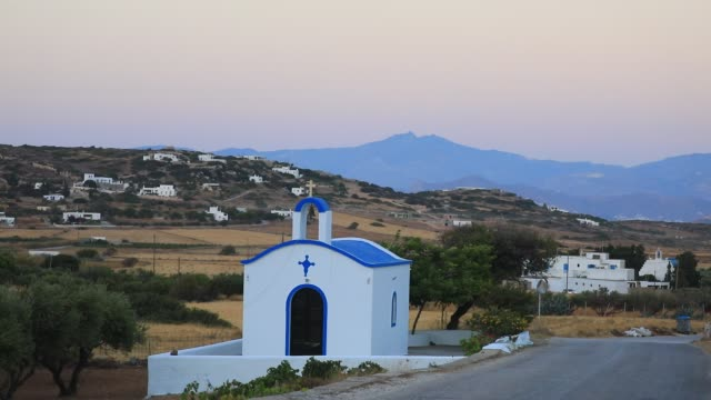 stockvideo's en b-roll-footage met traditional church on the side of a road on august 14 2020 in kostos greece the island of paros has seen increasing tourist numbers in recent years... - charmant