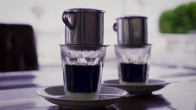 traditional coffee dripping in vietnam style in coffee shop cafe - vietnam stock videos & royalty-free footage