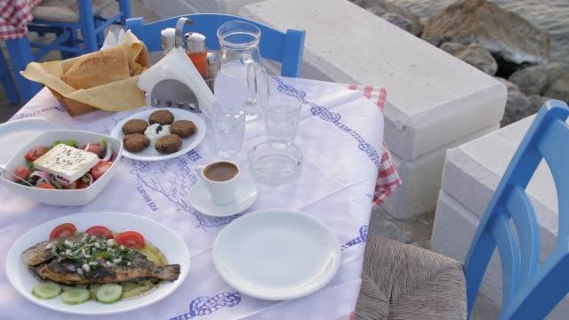 traditional cretan dorado fish with greek salad, kissamos, crete, greek islands, greece, europe - feta stock videos & royalty-free footage