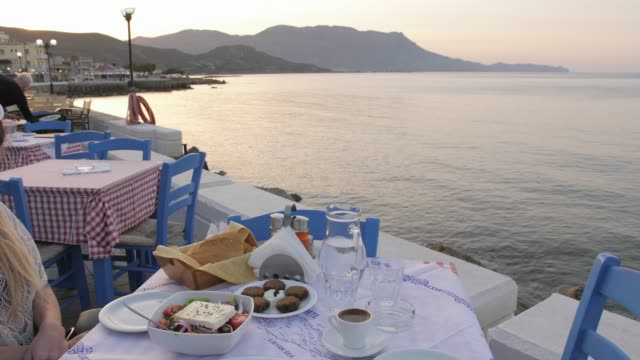 traditional cretan dorado fish with greek salad, kissamos, crete, greek islands, greece, europe - jug stock videos & royalty-free footage