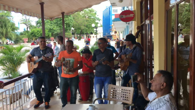 traditional cuban music group playing for tourists in a patio bar and restaurant everyday lifestyle of cuban people in the socialist communist... - plucking an instrument stock videos and b-roll footage