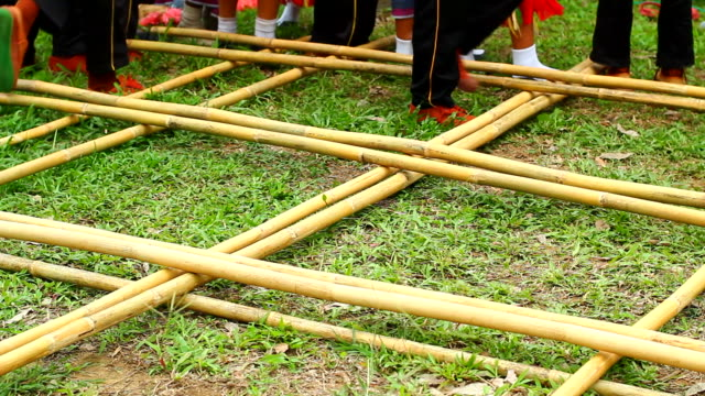 Traditional dance with native bamboo stick