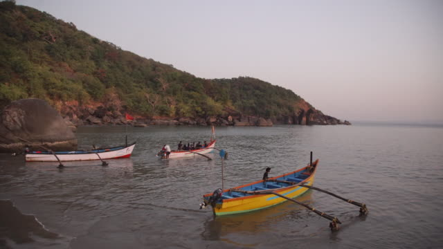 traditional fishermen bringing boats to shore - india - fisherman stock videos & royalty-free footage
