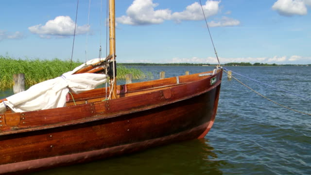 traditional fishing boat in lagoon harbour - baltic sea stock videos and b-roll footage
