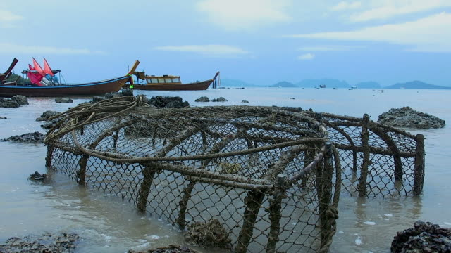 Traditional fishing equipment and Longtail boat