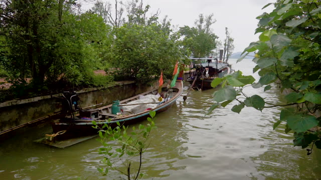 Traditional fishing Longtail boats on canal