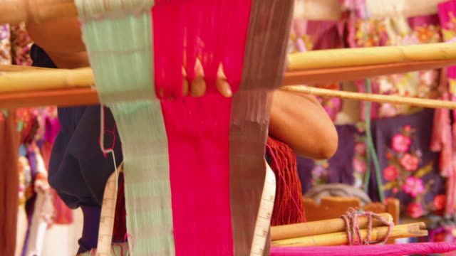 traditional handloom weaver braiding colorful threads in zinacantan, chiapas, mexico - waist stock videos & royalty-free footage